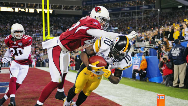 2009-0201-Super-Bowl-XLIII-Santonio-Holmes-Aaron-Francisco-opgm-51894.jpg