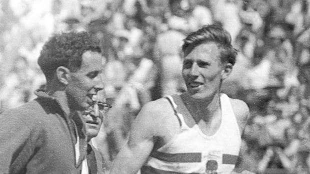 MILES TO GO Landy, Schulman and Bannister (left to right) helped get SI moving in '54.