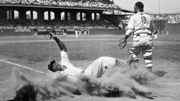 ELECTRIC SLIDE Josh Gibson (crossing the plate during a Negro leagues All-Star Game in 1944) may well be the best power-hitting catcher—any league, any era. He was known as the Black Babe Ruth, though some who saw him play refer to the Bambino as the white Josh Gibson.