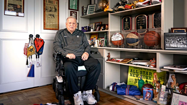 TEAM PLAYER Turetzky, who has been on the job courtside for 54 years, keeps a shrine to the Nets in his apartment.