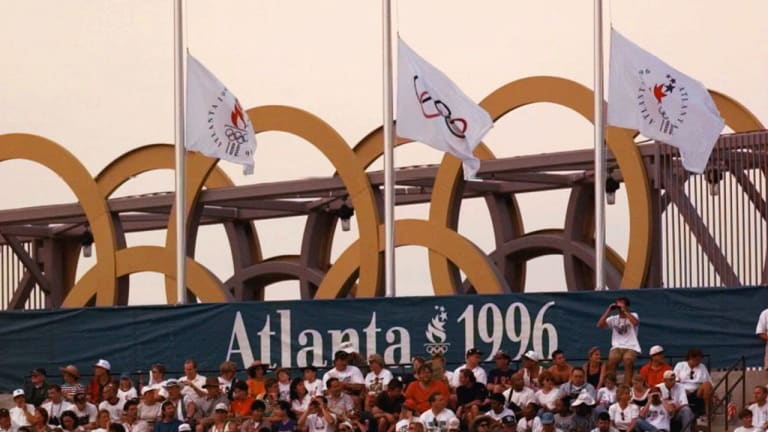 Mourning After A Bomb Blast in Centennial Olympic Park Tainted The Games Forever