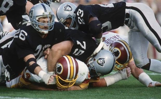 1984-0122-Super-Bowl-XVIII-Howie-Long-Vann-McElroy-001092126.jpg