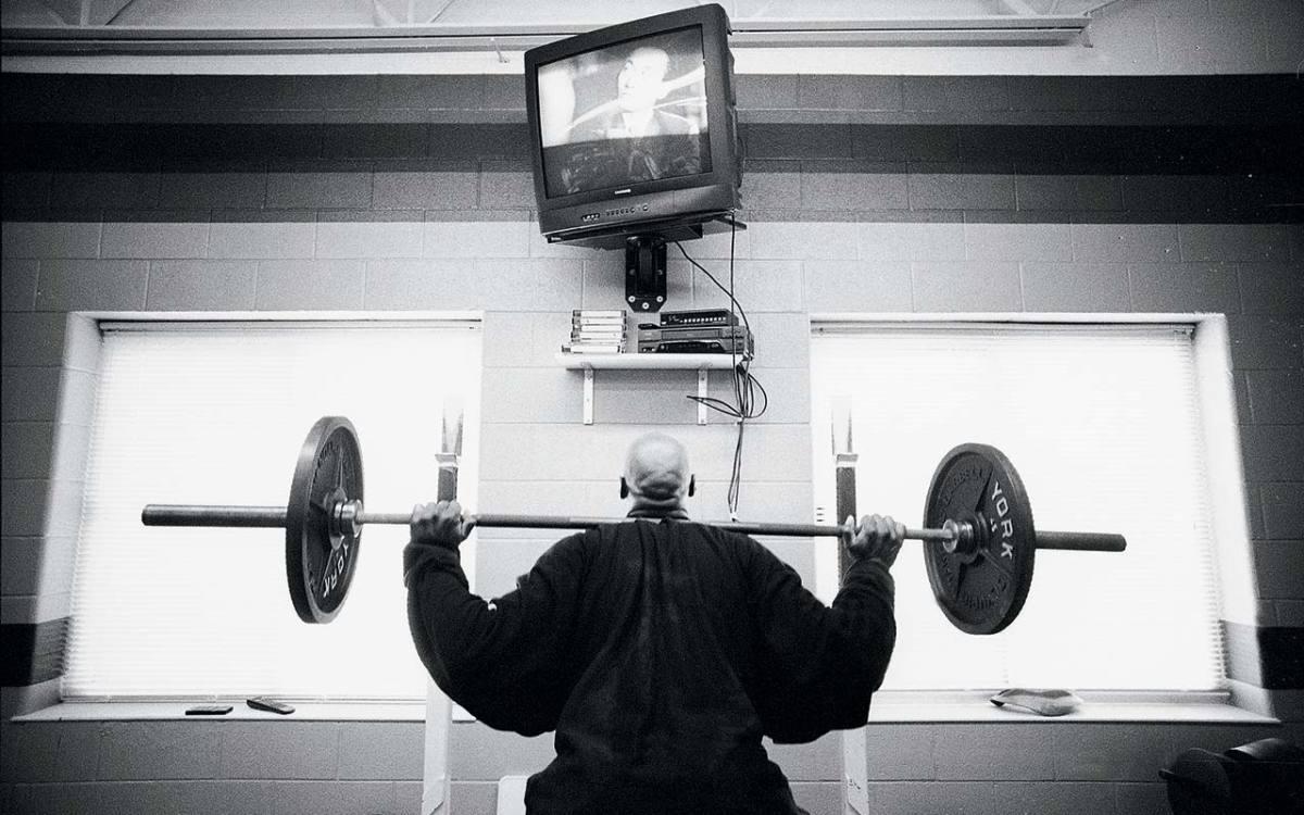 scott-burrell-lifting-weights-behind-closed-doors-vault.jpg