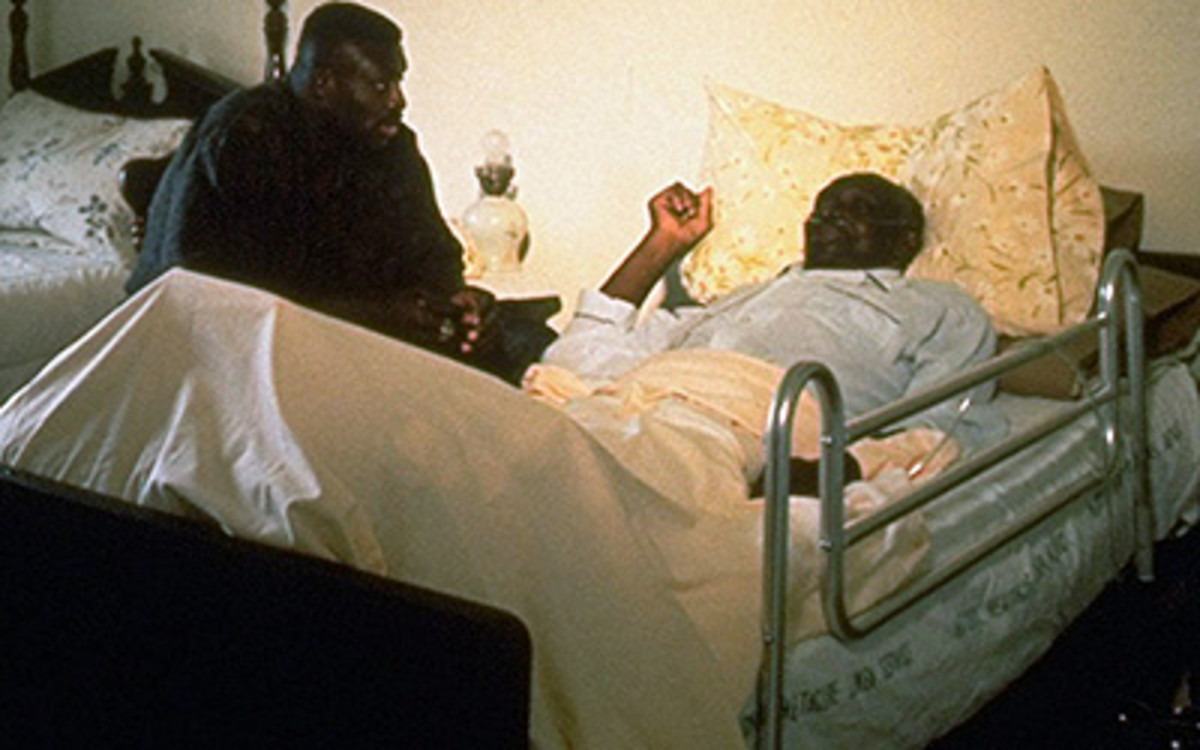 Bruce Smith at the bedside of his father, George.