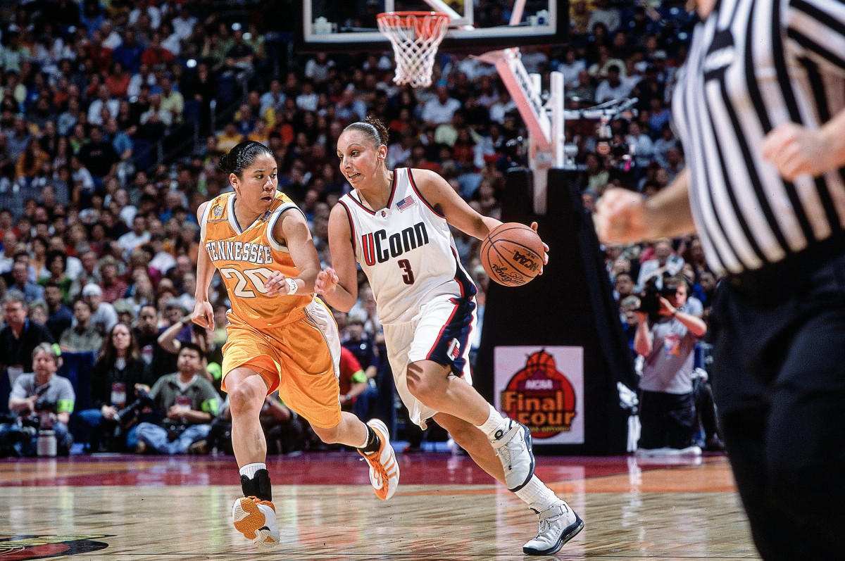 Tennessee's Kara Lawson (20) in action against UConn's Diana Taurasi(3) in first half action of a semifinal at the 2002 NCAA Women's Final Four at the Alamodome/San Antonio, TX., 03/29/02.