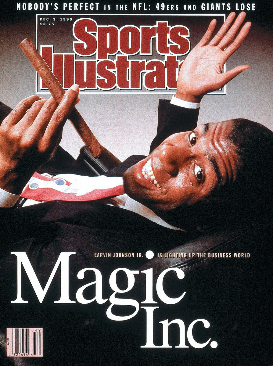 December 3, 1990 Sports Illustrated Cover: Casual portrait of Los Angeles Lakers Magic Johnson (32) wearing suit and smoking cigar during photo shoot at home. Los Angeles, CA 10/25/1990