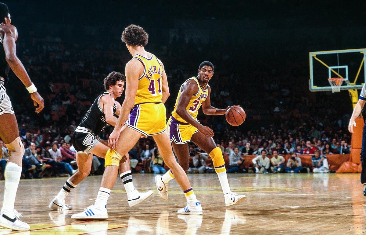 Los Angeles Lakers #32 Earvin Magic Johnson dribbles basketball vs. San Antonio Spurs, 11/20/81, Inglewood, California.  Lakers win 136-116.