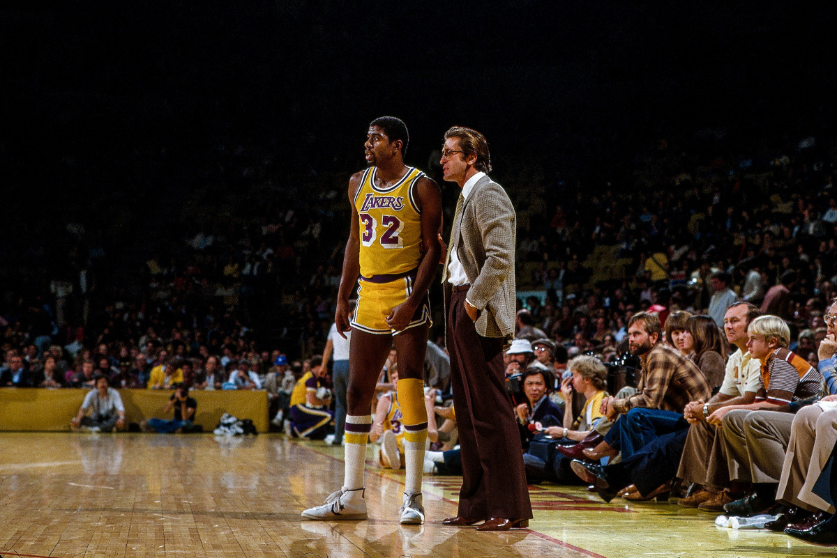 Los Angeles Lakers Magic Johnson (#32) with assistant coach Pat Riley on sidelines during game vs San Antonio Spurs at The Forum.   Lakers win 136-116.  Inglewood, CA 11/20/1981.