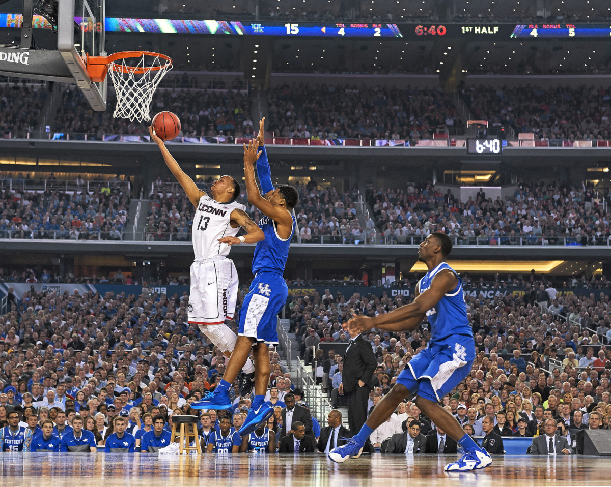 under fire Napier (above) led the Huskies to the 2014 NCAA championship, but his comments about going to bed hungry made headlines—and caught the attention of Booker, who had joined the Senate in '13.