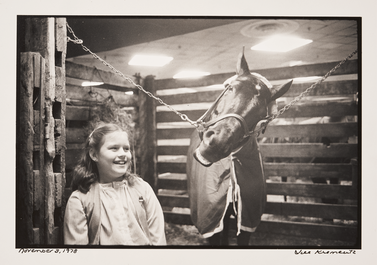 BETTOR DAYS Ax stayed close to the track, and to his daughter—which often placed young Megan in equine company.