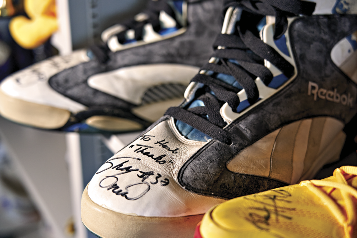 """SHAQ'S SHOES A 1993 Shaquille O'Neal dunk brought down the basket near Turetzky's son, David, who was a ball boy. Shaq's advice the following year: """"Stay away from falling baskets."""""""