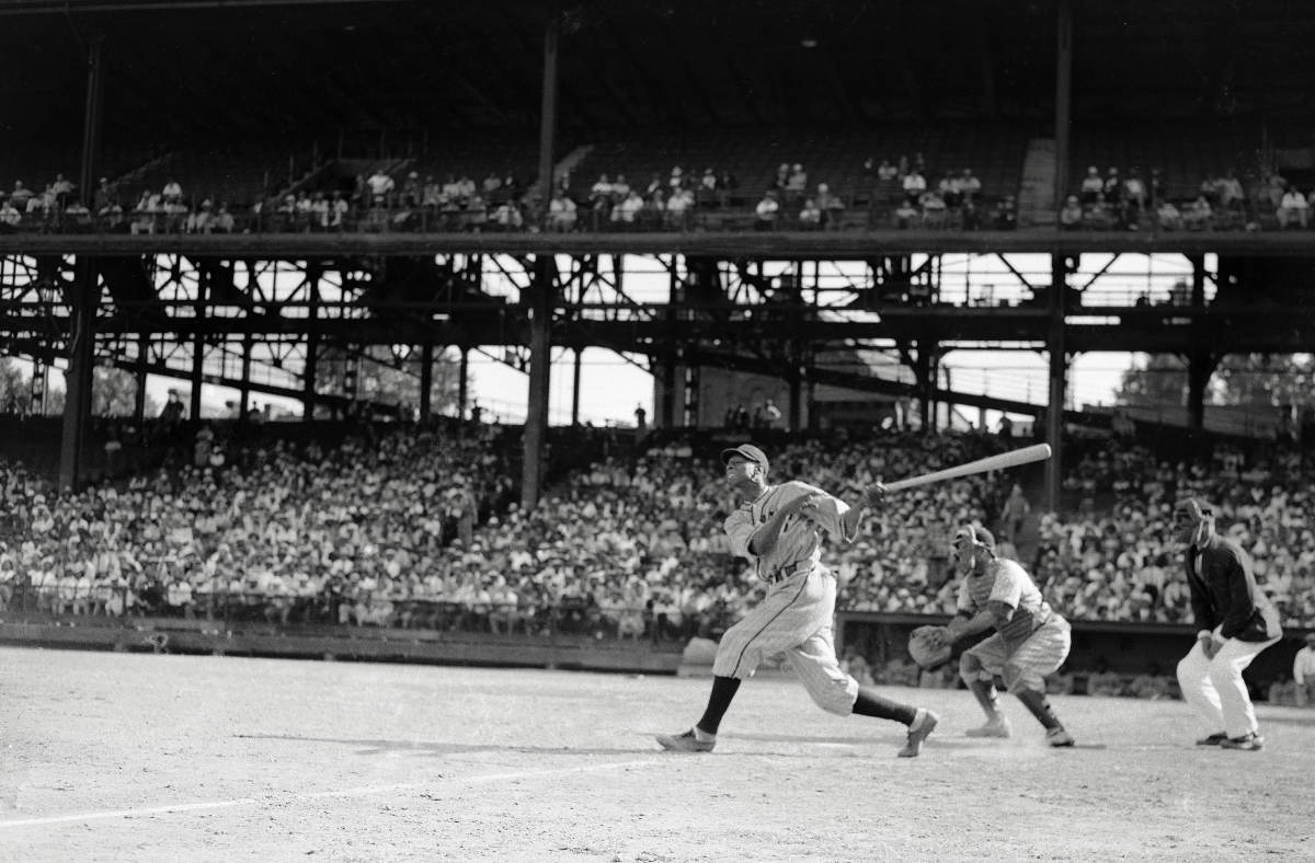 CROWD-PLEASERS If the Negro leagues lacked big league status, it was in name only: The Homestead Grays, who split time between Pittsburgh and Washington, D.C., drew huge crowds at Forbes Field (pictured, with Robert Gaston hitting in 1942) and Griffith Stadium.