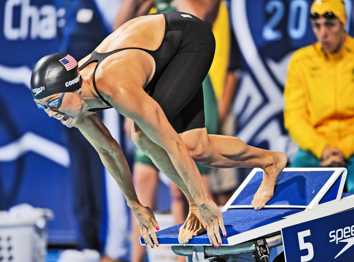 DIVING IN Coughlin, who won 12 medals at three Games, now uses her stroking power to punch down grapes.