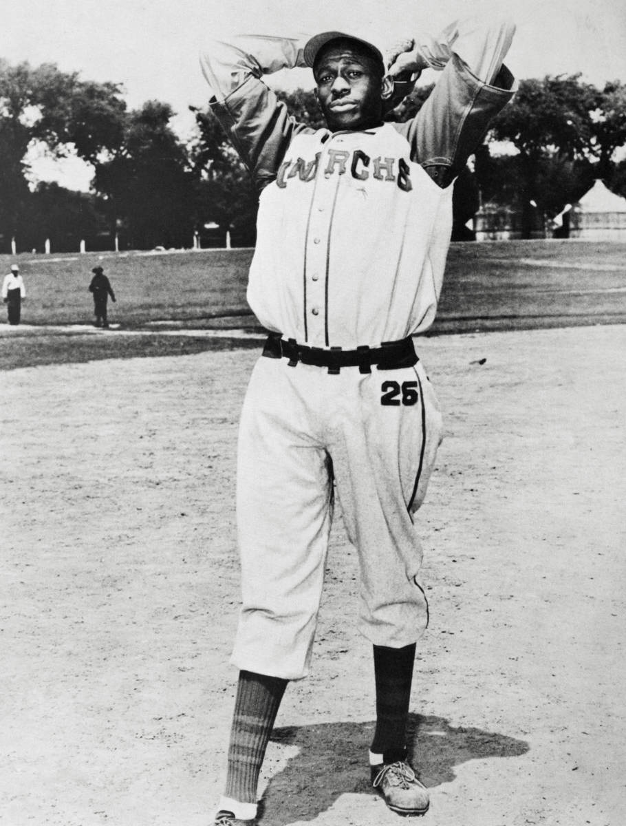 DO LOOK BACK Between 1948 and '52, a past-his-prime Satchel Paige (with the Kansas City Monarchs, c. 1940) won 28 games in the American League. With his Negro leagues victories counted as official stats, his major league career total will grow to at least 170.